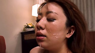 Nippon MILF gets her face creamed by two guys