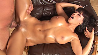 Hot blackhaired MILF gets a royal titfucking
