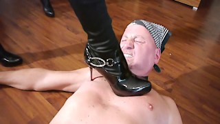 German femdoms kick him till he cums
