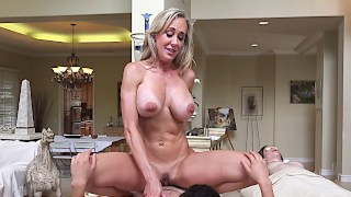 MILF with huge jugs treas a penis with her careful hand and cooch