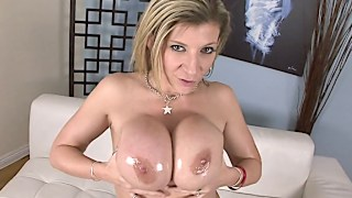 Boobylicious blonde gets oily for the huge black knob